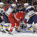 St. Louis Blues' Carl Gunnarsson (4), of Sweden, Kevin Shattenkirk and T.J. Oshie, right, defend the goal against Carolina Hurricanes' Eric Staal (12) during the second period of an NHL hockey game in Raleigh, N.C., Friday, Jan. 30, 2015 The Associated Pr
