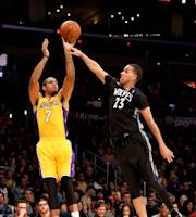 LOS ANGELES, CA - DECEMBER 20: Xavier Henry #7 of the Los Angeles Lakers shoots over Kevin Martin #23 of the Minnesota Timberwolves at Staples Center on December 20, 2013 in Los Angeles, California. (Photo by Stephen Dunn/Getty Images)