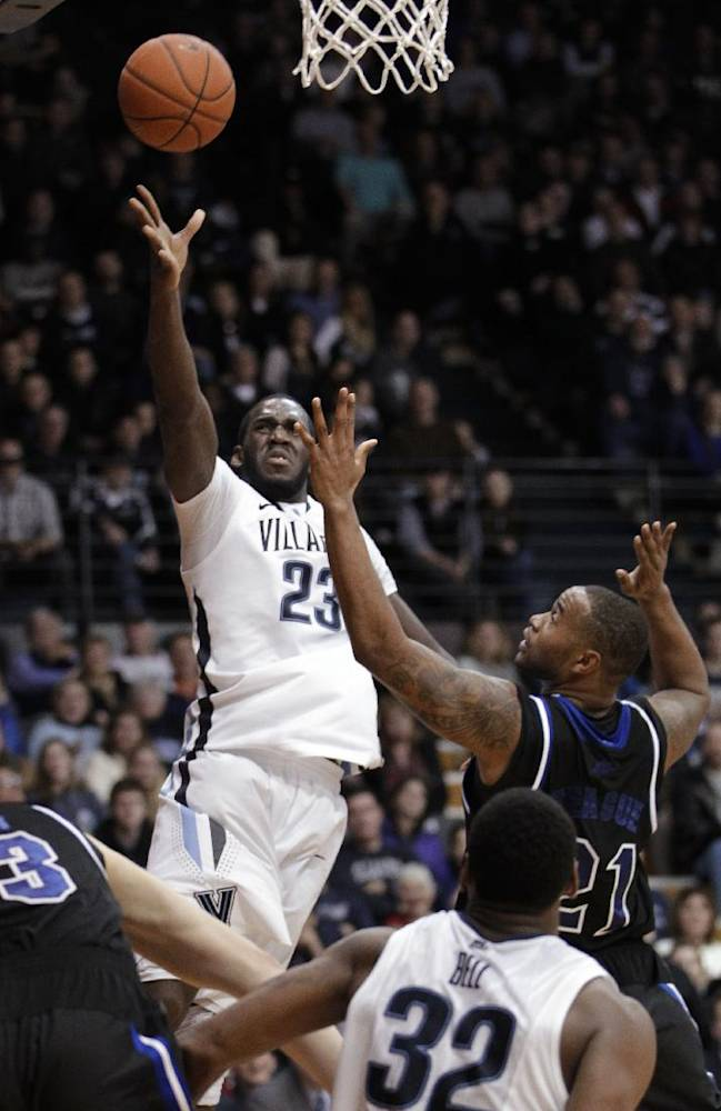 Villanova's Daniel Ochefu (23) takes a shot past Seton Hall's Eugene Teague (21) during the second half of an NCAA college basketball game, Friday, Feb. 7, 2014, in Villanova, Pa. Villanova won 70-53