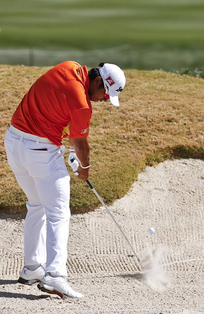 Hideki Matsuyama, of Japan, hits from the fairway bunker on the eighth hole in his match against Graeme McDowell, of Northern Ireland, during the second round of the Match Play Championship golf tournament on Thursday, Feb. 20, 2014, in Marana, Ariz