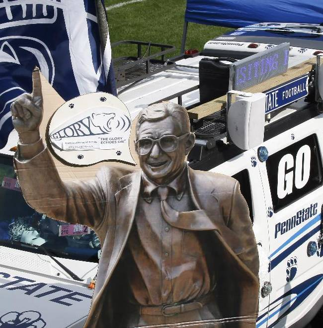 A cardboard cutout with the image of the statue of former Penn State football coach Joe Paterno is part of the decoration of a fan's tailgate setup near where the real statue was outside Beaver Stadium before the NCAA football game between Penn State and Massachusetts on Saturday, Sept. 20, 2014 in State College, Pa