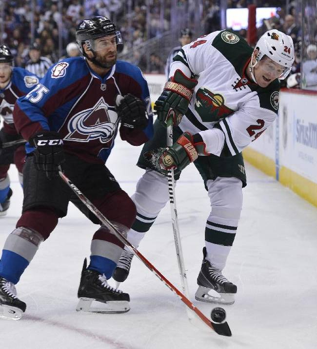 Colorado Avalanche center Maxime Talbot (25) and Minnesota Wild left wing Matt Cooke (24) skate in the first period of Game 2 of an NHL hockey first-round playoff series on Saturday, April 19, 2014, in Denver