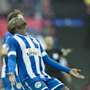 Wigan Athletic's Marc-Antoine Fortune reacts, during their English FA Cup semifinal soccer match against Arsenal, at the Wembley Stadium in London, Saturday, April 12, 2014