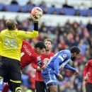Cardiff City's Steven Caulker, 2nd left, and Wigan Athletic's goalkeeper Ali Al-Habsi, left, in action during their FA Cup, Fifth round soccer match at The Cardiff City Stadium, Cardiff, Wales, Saturday Feb. 15, 2014. (AP Photo / PA )