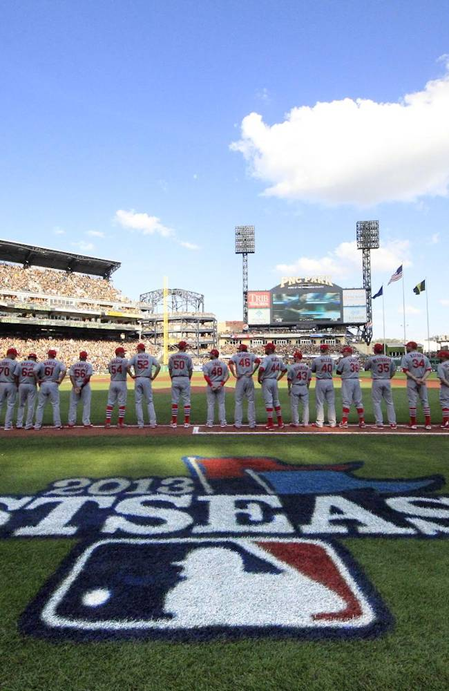 The St. Louis Cardinals line up on the first base line during the introductions for Game 3 of a National League division baseball series against the Pittsburgh Pirates on Sunday, Oct. 6, 2013 in Pittsburgh , PA
