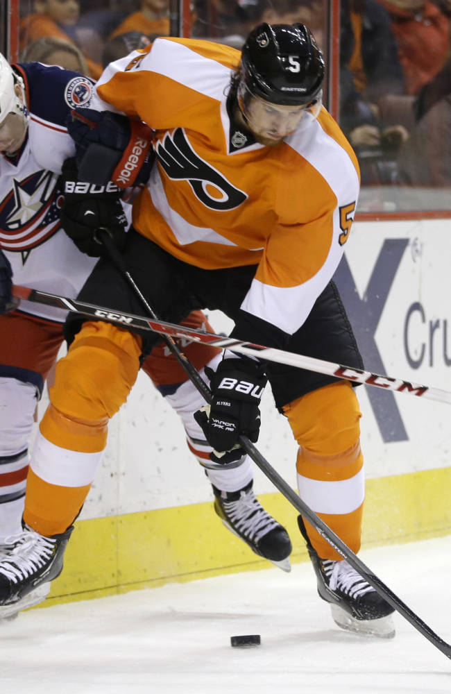 Philadelphia Flyers' Braydon Coburn, right, and Columbus Blue Jackets' Matt Calvert vie for the puck during the first period of an NHL hockey game, Thursday, Dec. 19, 2013, in Philadelphia