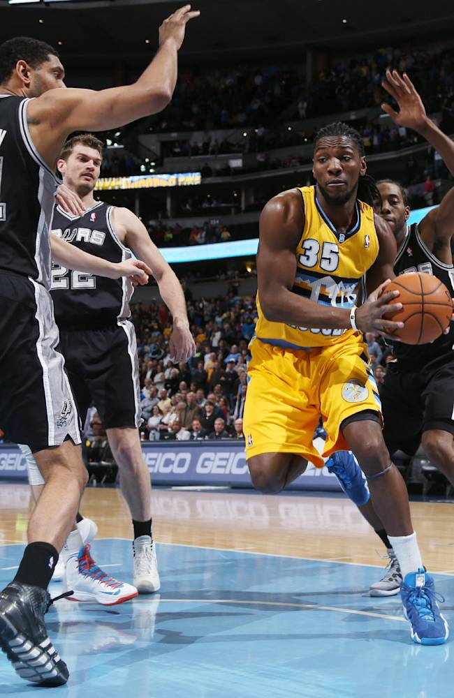 Denver Nuggets forward Kenneth Faried, front right, picks up a loose ball in the lane as, from left, San Antonio Spurs center Tim Duncan and forwards Tiago Splitter, of Brazil, and Kawhi Leonard cover in the first quarter of an NBA basketball game in Denver, Friday, March 28, 2014