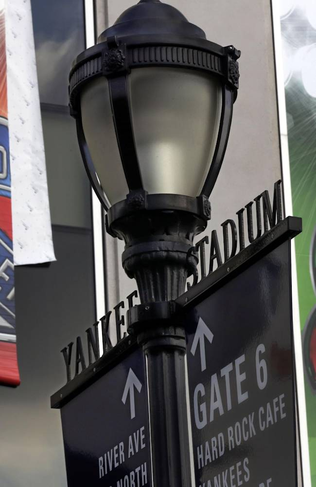 Banners are hung outside New York's Yankee Stadium, Saturday, Jan. 18, 2014, for NHL Stadium Series games. The stadium will host the New York Rangers and New Jersey Devils on Jan. 26 and the Rangers-New York Islanders on Jan. 29