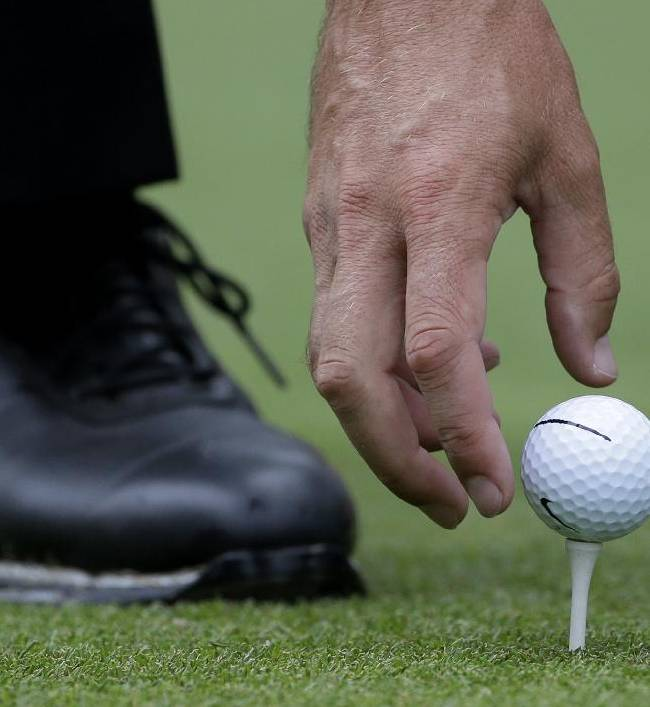 Charl Schwartzel, of South Africa, places his ball before teeing off the 16th hole during the third round of play in the Tour Championship golf tournament at East Lake Golf Club, in Atlanta, Saturday, Sept. 21, 2013
