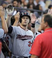 Minnesota Twins' Justin Morneau celebrates his two-run home run against the Detroit Tigers in the fourth inning of a baseball game in Detroit, Tuesday, Aug. 20, 2013. (AP Photo/Paul Sancya)