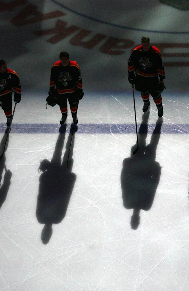 SUNRISE, FL - NOVEMBER 24: The starting lineup of the Florida Panthers stand silhouetted at the blueline during the pregame ceremony before their game against the Ottawa Senators on November 24, 2006 at the Bank Atlantic Center in Sunrise, Florida. The Senators defeated the Panthers 6-4. (Photo by Marc Serota/Getty Images)