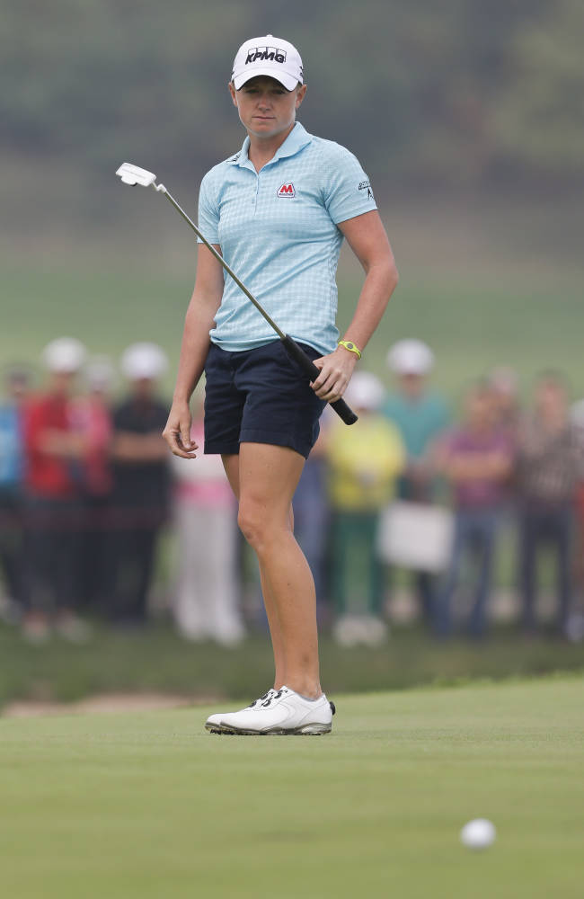 Feng's late eagle gives her Reignwood Classic win