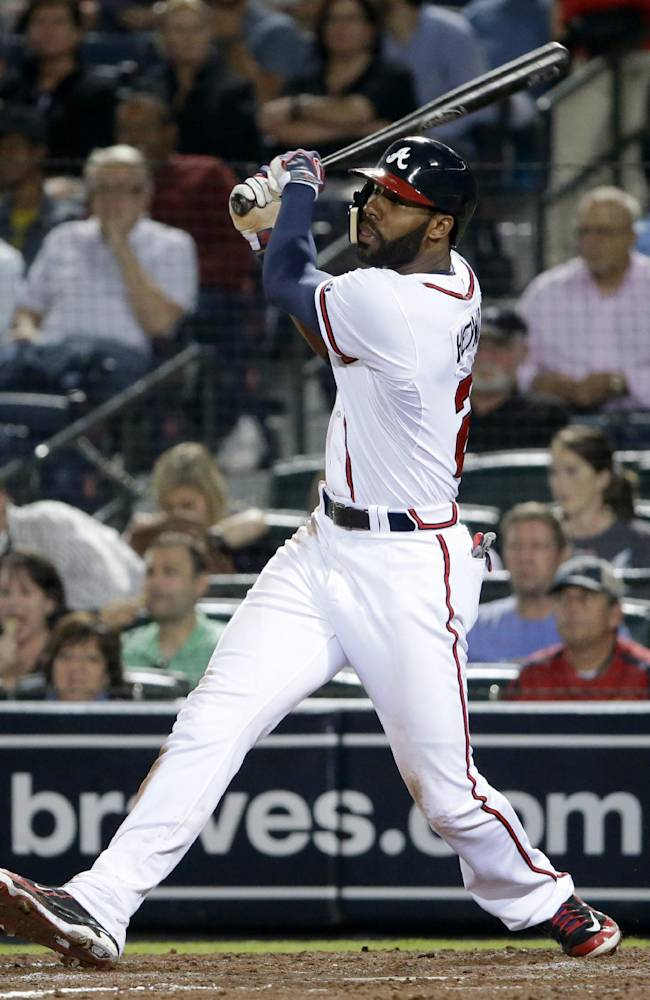 Atlanta Braves' Jason Heyward hits a double in the fifth inning of a baseball game against the Philadelphia Phillies, Thursday, Sept. 26, 2013, in Atlanta