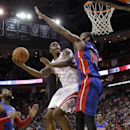 Houston Rockets forward Terrence Jones (6) is met by Detroit Pistons' Greg Monroe (10) as he drives to the basket during the second half of an NBA basketball game, Saturday, March 1, 2014, in Houston. Houston won 118-110 The Associated Press