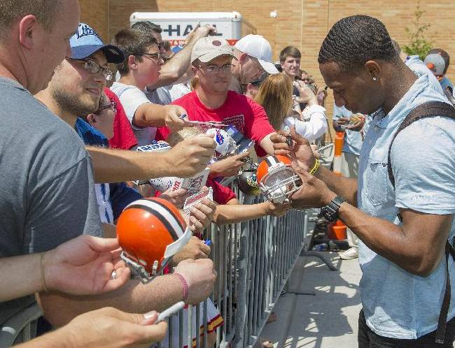 Cleveland Browns rookie Justin Gilbert signs autographs after leaving the 2014 NFL Rookie Symposium at the Pro Football Hall of Fame in Canton, Ohio, Saturday, June 28, 2014