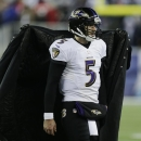 Baltimore Ravens quarterback Joe Flacco is covered with a jacket as he walks to the sideline in the second half of an NFL divisional playoff football game against the New England Patriots Saturday, Jan. 10, 2015, in Foxborough, Mass The Associated Press