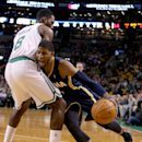 Indiana Pacers small forward Paul George, right, drives into Boston Celtics small forward Jeff Green (8) during the first half of an NBA basketball game on Saturday, March 1, 2014, in Boston The Associated Press
