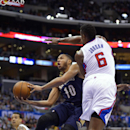 New Orleans Pelicans guard Eric Gordon, left, puts up a shot as Los Angeles Clippers center DeAndre Jordan defends during the first half of an NBA basketball game, Saturday, March 1, 2014, in Los Angeles The Associated Press