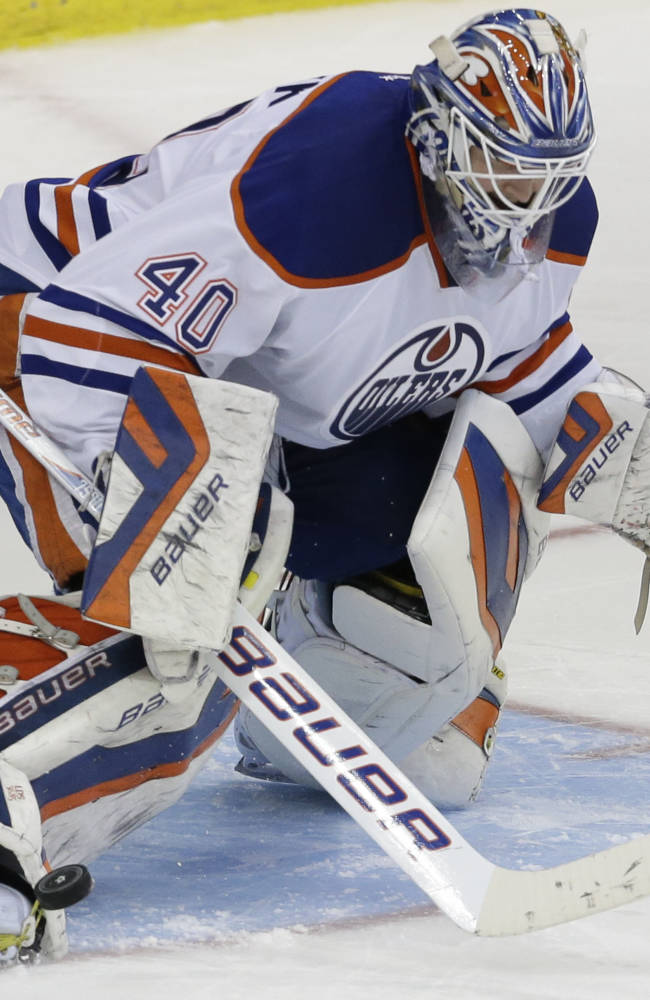 Edmonton Oilers goalie Devan Dubnyk (40) stops a shot during the shootout of an NHL hockey game against the Dallas Stars Sunday, Dec. 1, 2013, in Dallas. Th Oilers won 3-2