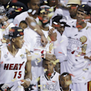 FILE - In this June 21, 2013 file photo, Miami Heat players including LeBron James, top center, celebrate after Game 7 of the NBA basketball championship game against the San Antonio Spurs, in Miami. As he walked off the court for the final time last season, LeBron James shouted to no one in particular,