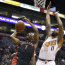 Toronto Raptors' Kyle Lowry (7) drives to the basket for a lay-up as Phoenix Suns' Markieff Morris (11) defends during the second half of an NBA basketball game on Friday, Dec. 6, 2013, in Phoenix The Associated Press