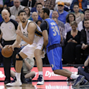 Dallas Mavericks' Brandan Wright (34) defends Utah Jazz's Enes Kanter, of Turkey, during the second quarter of an NBA basketball game Tuesday, April 8, 2014, in Salt Lake City The Associated Press