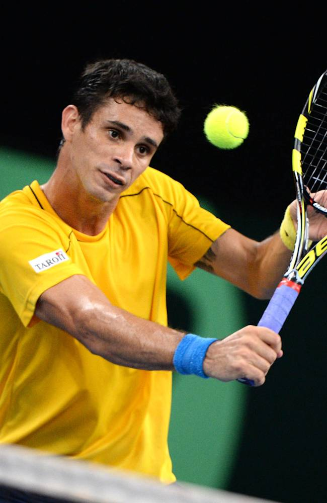 Brazil's Rogerio Dutra  da Silva  returns a ball to Florian Mayer from Germany during their single match of the tennis Davis Cup play off round , in Neu-Ulm, Germany, Sunday Sept. 15, 2013