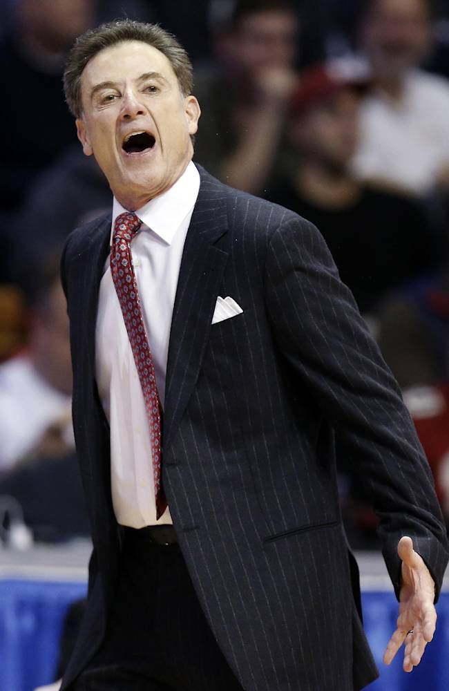 Louisville head coach Rick Pitino reacts during the first half of an NCAA college basketball game against North Carolina in the Basketball Hall of Fame Tip-Off tournament championship at Mohegan Sun Arena in Uncasville, Conn., Sunday, Nov. 24, 2013