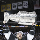 Los Angeles Kings right wing Marian Gaborik, of Slovakia, carries the Stanley Cup after beating the New York Rangers in double in Game 5 of the NHL Stanley Cup Final series Friday, June 13, 2014, in Los Angeles The Associated Press