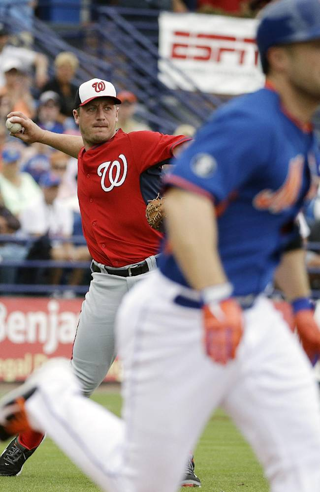 Washington Nationals starting pitcher Jordan Zimmermann, left, throws to first base after fielding a ground out by New York Mets' David Wright, right, in the first inning of an exhibition spring training baseball game, Thursday, March 27, 2014, in Port St. Lucie, Fla