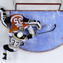 Boston Bruins' Patrice Bergeron (37) scores past Philadelphia Flyers' Steve Mason (35) during a shootout in an NHL hockey game, Sunday, March 30, 2014, in Philadelphia. Boston won 4-3 The Associated Press