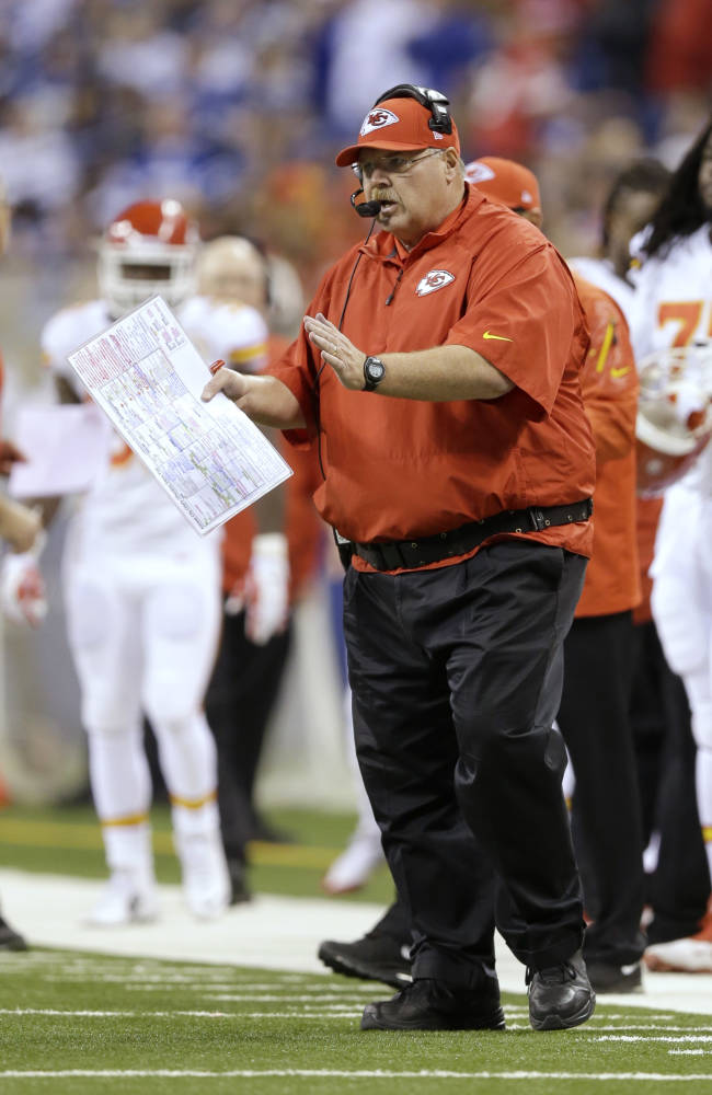 Kansas City Chiefs head coach Andy Reid directs play from the sideline against the Indianapolis Colts during the first half of an NFL wild-card playoff football game Saturday, Jan. 4, 2014, in Indianapolis
