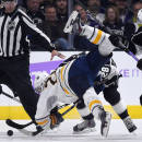Buffalo Sabres center Zemgus Girgensons, left, of Latvia, tangles with Los Angeles Kings center Jarret Stoll on a face-off during the second period of an NHL hockey game, Thursday, Oct. 23, 2014, in Los Angeles. (AP Photo/Mark J. Terrill)