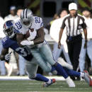 Dallas Cowboys' DeMarco Murray (29) attempts to fight off a tackle attempt by New York Giants' Zack Bowman (31) after a short run during the second half of an NFL football game, Sunday, Oct. 19, 2014, in Arlington, Texas. (AP Photo/Brandon Wade)