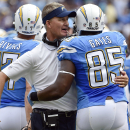 San Diego Chargers head coach Mike McCoy, center, celebrates a touchdown from tight end Antonio Gates, right, as quarterback Philip Rivers walks past during the first half of an NFL football game Sunday, Oct. 19, 2014, in San Diego The Associated Press