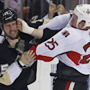 Ottawa Senators' Chris Neil (25) lands a punch on the face of Pittsburgh Penguins' Tanner Glass (15) during a fight in the first period of an NHL hockey game in Pittsburgh, Sunday, April 13, 2014. Both players received 5-minute penalties for fighting The