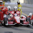 Scott Dixon, of New Zealand, pits his car during the IndyCar Grand Prix of Baltimore auto race on Sunday, Sept. 1, 2013, in Baltimore. (AP Photo/Nick Wass)