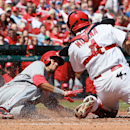 Cincinnati Reds' Billy Hamilton scores past St. Louis Cardinals catcher Yadier Molina on a sacrifice fly in fifth inning action during a game between the St. Louis Cardinals and the Cincinnati Reds on Wednesday, April 9, 2014, at Busch Stadium in St. Loui