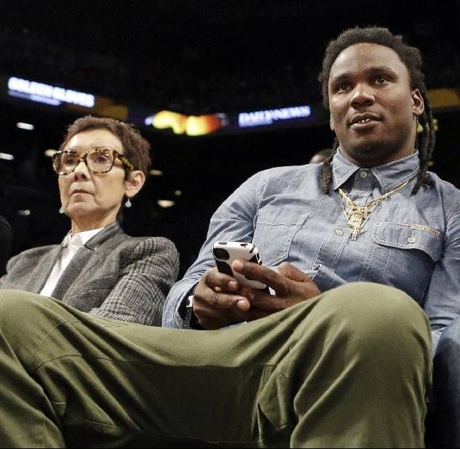 Former Tennessee Titans running back Chris Johnson watches the second half of an NBA basketball game between the New York Knicks and the Brooklyn Nets Tuesday, April 15, 2014, in New York. The The Knicks won 109-98