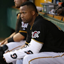 Pittsburgh Pirates starting pitcher Francisco Liriano (47) sits in the dugout with his arm wrapped after pitching the first inning inning of a baseball game against the Cincinnati Reds in Pittsburgh Monday, April 21, 2014 The Associated Press