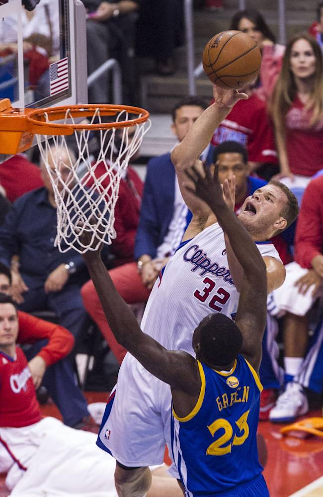 Los Angeles Clippers forward Blake Griffin (32) goes up  against Golden State Warriors forward Draymond Green (23) during the first half of Game 7 of a first-round NBA basketball playoff series, Saturday, May 3, 2014, in Los Angeles