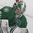 Dallas Stars goalie Kari Lehtonen (32) stops the puck during the second period of an NHL hockey game against the Buffalo Sabres Monday, March 3, 2014, in Dallas The Associated Press