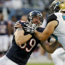 In this Aug. 14, 2014, file photo, Chicago Bears defensive end Jared Allen (69) tries to move around Jacksonville Jaguars tackle Luke Joeckel (76) during an NFL preseason football game in Chicago. Allen insisted this week he is as lively as ever and conce