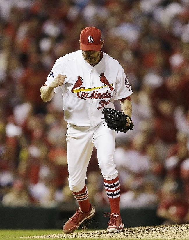 St. Louis Cardinals relief pitcher John Axford reacts after getting Los Angeles Dodgers' Nick Punto to strike out during the 11th inning of Game 1 of the National League baseball championship series Friday, Oct. 11, 2013, in St. Louis