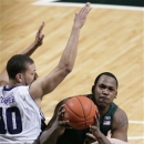 Michigan State's Derrick Nix, right, maneuvers for a shot against Northwestern's Mike Turner during the first half of an NCAA college basketball game, Sunday, March 10, 2013, in East Lansing, Mich. (AP Photo/Al Goldis)