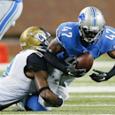Detroit Lions defensive back Nate Ness (47) intercepts a pass as Jacksonville Jaguars wide receiver Ramses Barden (9) brings him down in the second half of a preseason NFL football game at Ford Field in Detroit, Friday, Aug. 22, 2014 The Associated Press