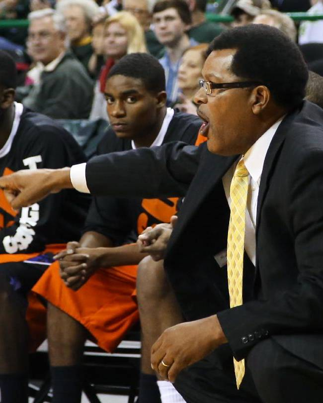 Savannah State coach Horace Broadnax directs an offensive play against Baylor during the first half of an NCAA college basketball game, Friday, Jan. 3, 2014, in Waco, Texas