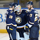 St. Louis Blues' goalie Jake Allen (34) is congratulated by Jay Bouwmeester (19) and Alex Peirtangelo (27) after their 2-0 victory over the Anaheim Ducks in an NHL hockey game, Thursday, Oct. 30, 2014, in St. Louis The Associated Press