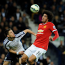 Manchester United's Marouane Fellaini, right, battles for the ball with West Bromwich Albion's Sebastien Pocognoli during the English Premier League soccer match between West Bromwich Albion and Manchester United at the Hawthorns, Birmingham, England, Mon