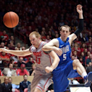 New Mexico's Alex Kirk, left, battles Air Force's Mike Fitzgerald for a loose ball in the first half of their NCAA college basketball game in Albuquerque, N.M., Wednesday, Feb. 6, 2013. (AP Photo/ Eric Draper)